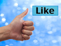 Thumb up to Like button Stock Images