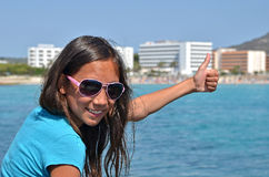 Thumb up for vacation Stock Image