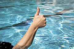 Thumb up in the water Stock Photo