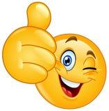 Thumb up winking emoticon. Emoticon winking and showing thumb up stock illustration