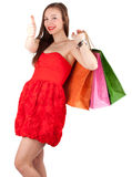 Thumb up woman with shopping bags Stock Images