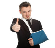Thumb up young businessman with broken hand Stock Image