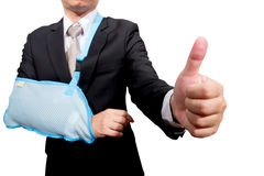 Thumb up young businessman with broken hand Stock Images