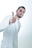 Thumb up. Young researcher wearing a labcoat showing thumb up Stock Photography