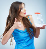 Thumb up, Young woman in blue evening dress hold white paper sh Royalty Free Stock Image