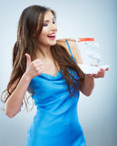 Thumb up, Young woman in blue evening dress hold white paper sh Royalty Free Stock Photos
