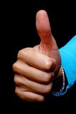 Thumb from a woman. A young woman holds her thumb up Royalty Free Stock Image