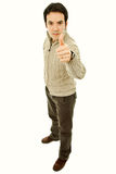 Thumb. Young casual man portrait in a white background royalty free stock photo