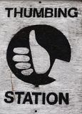 Thumbing station. Thumbing sign for hich hikers Stock Image