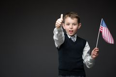 Thumbing up boy with American flag Royalty Free Stock Image