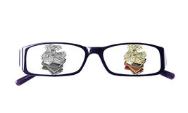 Thumbnails on financial topics in glasses Stock Images