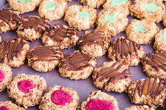 Thumbprint cookies with icing and nuts stock image