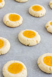 Thumbprint Cookies with Lemon Curd. Homemade thumbprint cookies a combination of sweet buttery cookies and citrusy topping and a hint of almonds Royalty Free Stock Photo