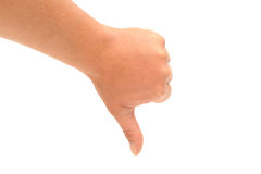 Thumbs down. Photograph of a hand with a thumbs down sign. shot in studio against a white background Royalty Free Stock Images