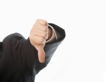 Thumbs down. Hand of man in suit giving thumbs down sign Royalty Free Stock Image