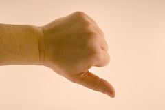 Thumbs down. A thumbs down on white background Royalty Free Stock Image