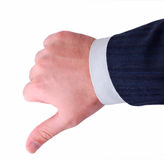 Thumbs down. Against white background Royalty Free Stock Photography