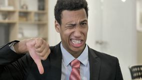 Thumbs Down by African Businessman stock footage