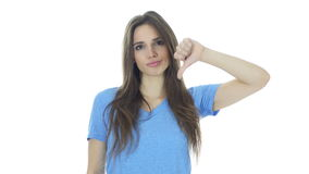 Thumbs Down By Beautiful Young  Woman, White Background,Young stock video footage
