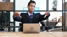 Thumbs Down by Black Businessman while Working on Laptop. Young creative designer , good looking stock footage