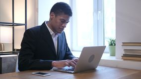 Thumbs Down by Black Businessman while Working on Laptop. Young creative designer , good looking stock video