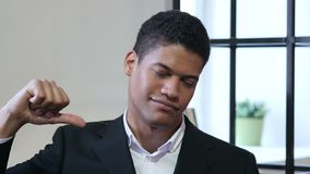 Thumbs Down by Black Businessman. Young creative designer , good looking stock footage