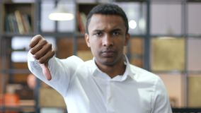 Thumbs Down by Black Man. Designer , young man , handsome stock footage