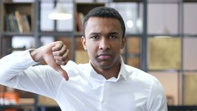 Thumbs Down by Black Man in Office stock footage