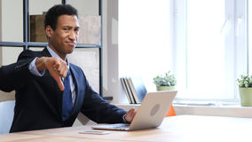 Thumbs Down by Black Man at Work, Both Hands Stock Photo