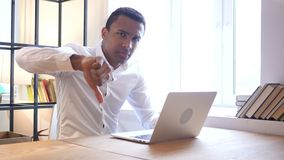 Thumbs Down by Black Man at Work. Designer , young man , handsome stock footage