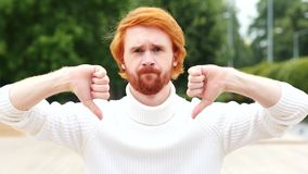 Thumbs Down with Both Hands by Man with Red Hairs, Outdoor. 4k , high quality stock video footage