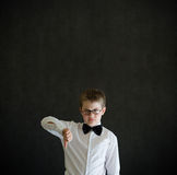 Thumbs down boy dressed up as business man Royalty Free Stock Images