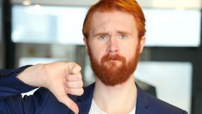 Thumbs Down by Businessman with Red Hair, Beard. Designer , young man , handsome stock footage