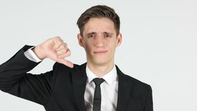 Thumbs down by businessman, white background stock video