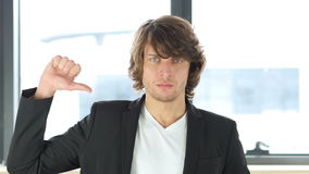 Thumbs Down by Casual Businessman. 4k  high quality stock footage