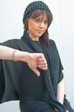 Thumbs down. Failure. An image of a woman whose thumb is pointing downwards indicating failure in some activity  with selective focus on the thumb Royalty Free Stock Images
