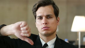 Thumbs Down by Frustrated, Angry Businessman in Office stock footage