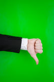 Thumbs down gesture on green Stock Image