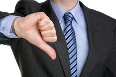 Thumbs down hand gesture. Business failure, businessman gesturing a thumbs down in displeasure Royalty Free Stock Image