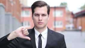 Thumbs Down by Happy Businessman, Outside Office. Creative designer , web designer stock video footage