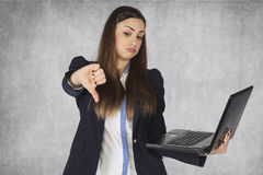Thumbs down for the info on the web. Business woman stock photo