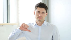 Thumbs Down by Man in Office, Indoor stock footage