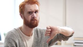 Thumbs Down by Man with Red Hairs. Young creative designer , good looking stock footage