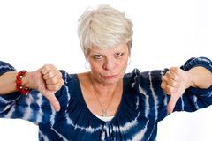 Thumbs down from a mature woman Royalty Free Stock Image