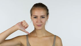 Thumbs Down, Portrait of Successful Beautiful Girl, White Background stock footage