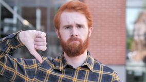 Thumbs Down by Redhead Beard Young Man, Outdoor. 4k high quality, 4k high quality stock footage