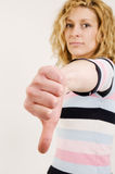 Thumbs down side view far Royalty Free Stock Photography