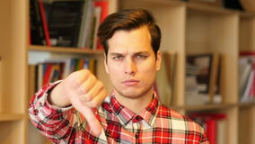 Thumbs Down by Unsatisfied  Young Man Indoor. Creative Designer stock video footage