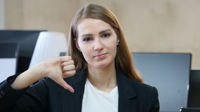 Thumbs Down by Woman in Office. Designer , young man , handsome stock video