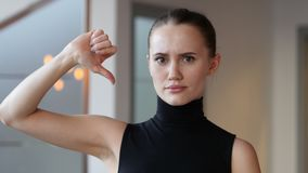 Thumbs Down by Woman in Office. 4k  high quality stock footage